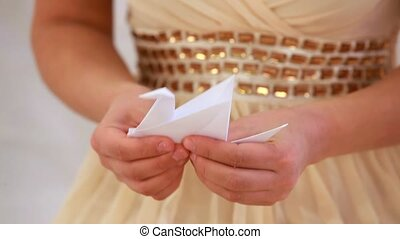 Hands Girls Doing Origami Crane. - Hands girls are folded...