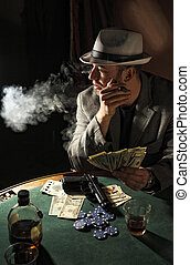 gangster smoking and play poker - portrait of young gangster...