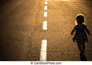 child on the road - Little girl running away on the road...