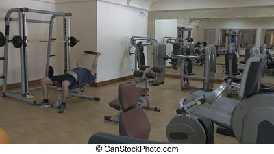 Two people working out in fitness center - View of modern...