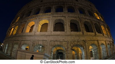 Illuminated Coliseum in Rome at night - Wide angle and dolly...