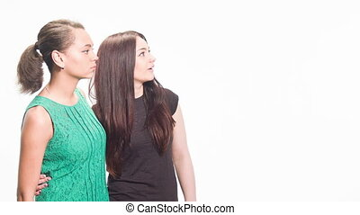 different women's emotions in the studio - two friends stand...
