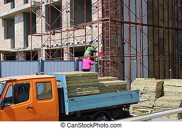 Women and construction. - Two women working at a...