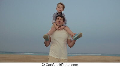 It's a great fun to ride on fathers shoulders
