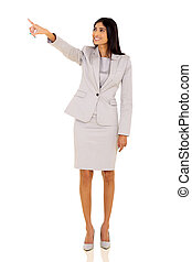 young indian businesswoman pointing