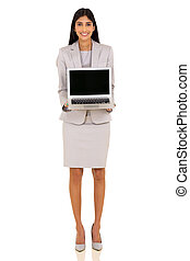 indian businesswoman presenting laptop
