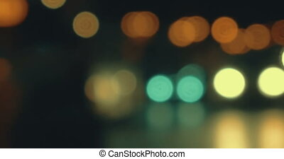 Blurry lights of traffic in city at night - Defocus of...