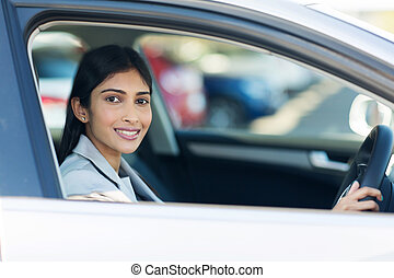 indian businesswoman inside her new car