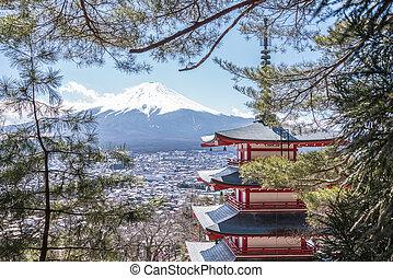 Mt Fuji with Chureito Pagoda at sunrise in autumn,...