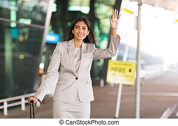 indian businesswoman hailing for a taxi