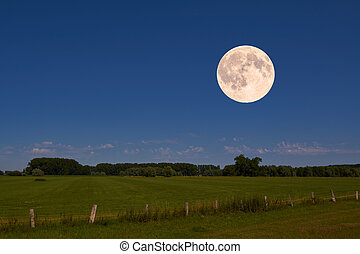 full moon - The bright full moon hovers over an idyllic...