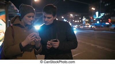 Man taking girls phone number in the street