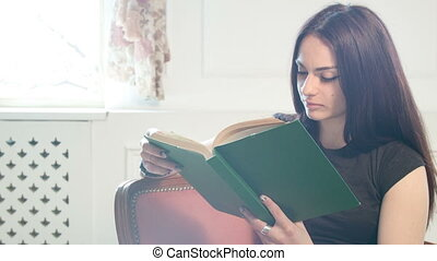 moderl life of a young lady - girl reading a book in...