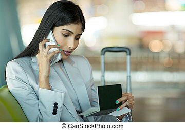 indian business woman talking on cell phone
