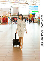 young indian woman going on a business trip