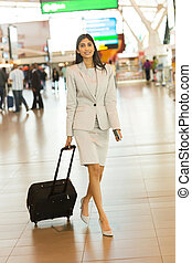 indian businesswoman walking in airport