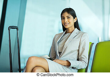 indian businesswoman waiting for her flight