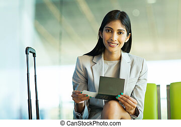 indian woman sitting at airport