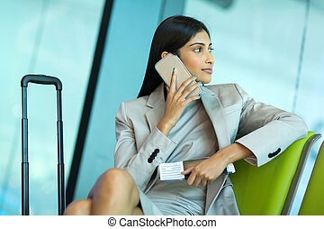 indian businesswoman talking on cell phone