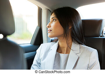 indian businesswoman in a car