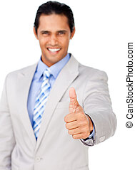 Portrait of an attractive businessman with thumb up against...