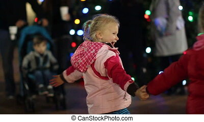 Girls Dancing at Christmas 2 - Slow motion - Two young...
