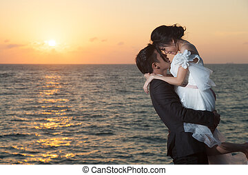 married couples - Married couples. Romantic behind the...