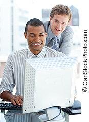 Joyful businessmen at a computer
