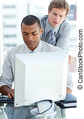 Concentrated businessmen at a computer