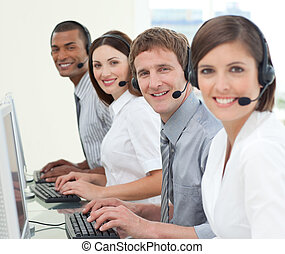 Multi-ethnic business people with headset on working in a...