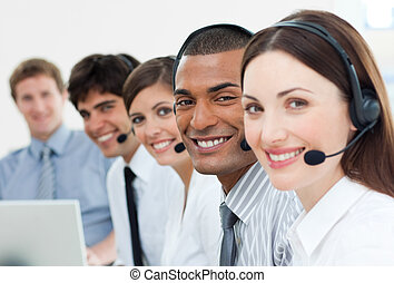 International customer service agents with headset on in a...