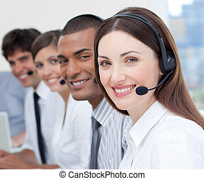 A group of customer service agents showing diversity in a...