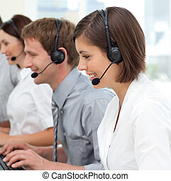 International business team with headset on working in a...