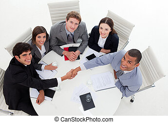 Internatonal Business people closing a deal in a meeting