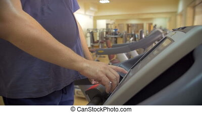 Man finishing his workout on treadmill - Man using treadmill...