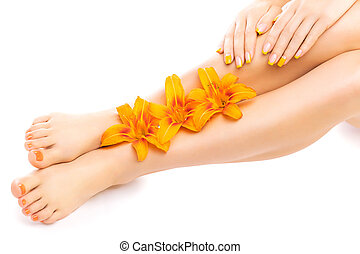 pedicure and manicure with a orange lily flower