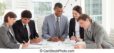 A diverse business group studying a budget plan in a meeting