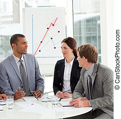 Manager and his team discussing a new strategy in a meeting