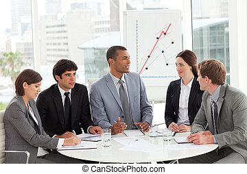 Business group studying sales report in a meeting