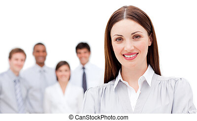 Attractive businesswoman with her team in the background