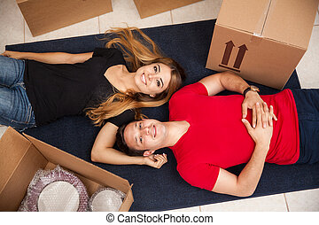 Happy newlyweds moving in - High angle view of a couple of...