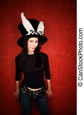 Woman in big hat with rabbit ears