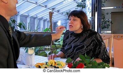 Senior Men And Women Eating Dessert On The Terrace. - DOLLY....