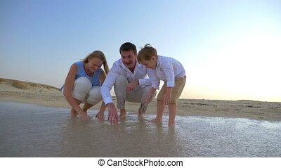 Family Spending Time by the Sea - Steadicam shot of a young...