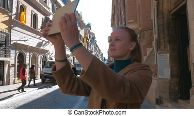 Woman making photos of European architecture