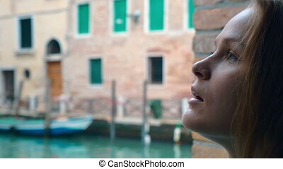 Woman with sad look outdoor in Venice - Slow motion close-up...