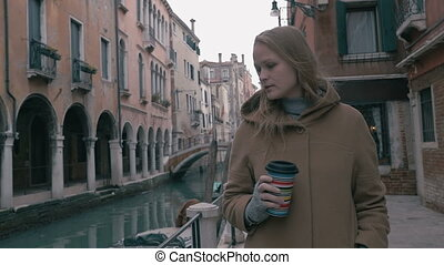 Woman with coffee walking in Venice - Slow motion steadicam...