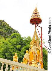 gold Buddha with high hairdo