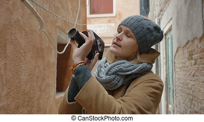 Female tourist using retro video camera outdoor - Slow...