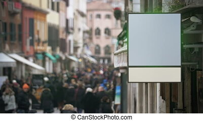 Blank banner hanging in crowded street - Slow motion of busy...